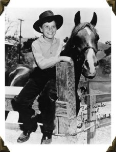 Autographed photo of Johnny Washbrook with Flicka.  Image via myfriendflicka.com